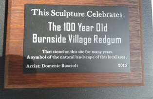 Engraved plaque on Sculpture Burnside Village